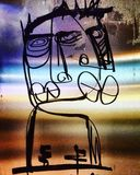 Grafittis grandes estranhos dos bordos da cara abstrata Imagem de Stock