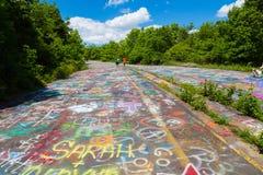 Grafittis na estrada da cidade fantasma do PA Fotografia de Stock Royalty Free