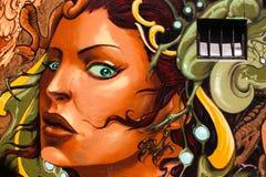 Grafittis na parede Imagens de Stock