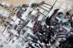 Grafittis na parede como um fundo Imagens de Stock