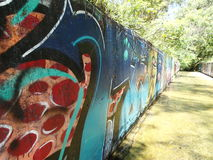 Grafittis na parede do canal Foto de Stock