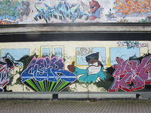 Grafittis na parede em Berlim Fotografia de Stock Royalty Free