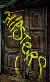 Grafittis na porta velha Fotografia de Stock