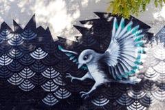 Grafittis - pássaro de voo Imagem de Stock