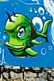 Grafittis pintados na parede do breackwater na porta o Fotografia de Stock