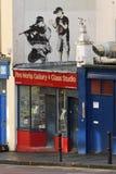 Grafittis por Banksy Imagem de Stock Royalty Free