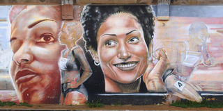 Grafittis que representam o arron atlético do chrisitne Fotos de Stock Royalty Free