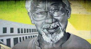 Grafittistående av David Suzuki av en okänd gatakonstnär Arkivfoto