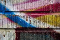 Grafittitegelstenvägg Royaltyfri Bild