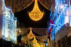 Grafton街道在都伯林,圣诞灯 题字` Nollaig Shona Duit `是`在爱尔兰语的愉快的圣诞节` 库存图片