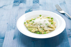 Gragnano pasta with fresh green peas. Italy royalty free stock images