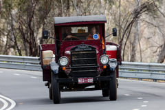1925 Graham Brothers 4 Cylinder Van driving on country road Royalty Free Stock Images