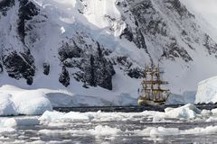 GRAHAM LAND, ANTARCTIC PENINSULA - FEBRUARY 14, 2011: Three-masted Dutch tall ship `bark Europa` anchored in Orne Harbour. stock photos
