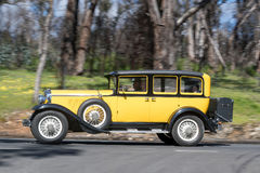 1929 Graham Paige 827 Sedan driving on country road Stock Photos