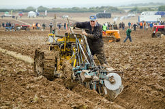 Graham Soper, Ploughman. BASINGSTOKE, UK - OCTOBER 12, 2014: Graham Soper making adjustments to his machinery while competing in the second day of the British Royalty Free Stock Image
