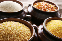 Grain. Different types of grain in the pots Stock Photo