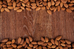 Grain almonds on a wooden background Stock Photo