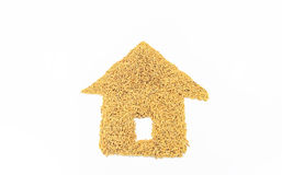 Grain arranged into the shape of a house. Jasmine rice is placed on a white background Royalty Free Stock Photos