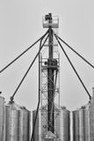 Grain auger and steel bins royalty free stock image