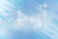 Grain background winter idyll with clouds and snow flakes lit by rays Stock Photography