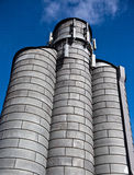 Grain Bin as a Cell phone Tower-Industrial. A metal grain storage silo is being used as a cell phone tower-cell phone industry Royalty Free Stock Image