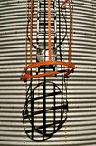 Grain bin cage and ladder. The cage and ladder of a new grain bin cast their shadow on the corrugated steel Stock Photos