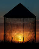 Grain Bin Sunset Silhouette Royalty Free Stock Photography