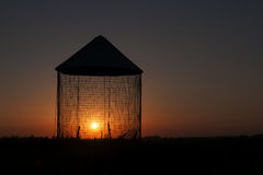Grain Bin Sunset Silhouette Royalty Free Stock Photos