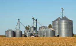 Grain Bins. Agricultural grain bins in a farm field Stock Photo