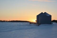Grain Bins. Freezing temperatures with farm silos Stock Photography