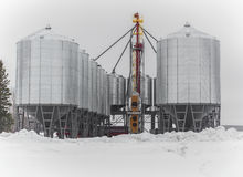 Grain bins. Steel grain bins in winter Royalty Free Stock Photography