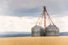 Grain Bins on a Stormy Day Stock Images
