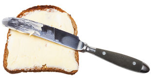 Grain bread and butter sandwich with table knife Stock Photo