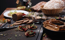 Grain bread and different spices Royalty Free Stock Photo
