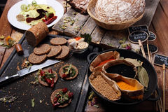 Grain bread and different spices Stock Photography
