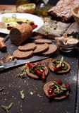 Grain bread and different spices Stock Photos
