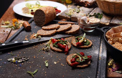 Grain bread and different spices Royalty Free Stock Image