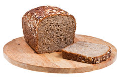 Grain bread loaf and sliced piece Stock Image