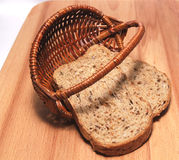 Grain bread in a wattled basket Royalty Free Stock Images