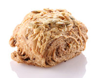 Grain bun close-up on a white background. Royalty Free Stock Photo