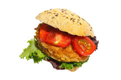 Grain bun with fried pork, lettuce and tomatoes Stock Photography