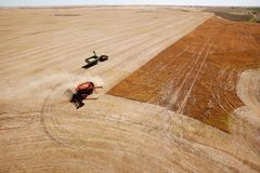 Grain Cart and Combine on Prairie Field Stock Photos