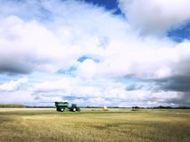 Grain cart and tractor in a rural countryside stock images