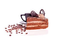 Grain coffee scattered,a cup and a piece of cake Royalty Free Stock Photos