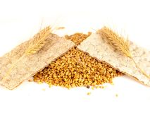 Grain crackers, biscuits and grains of wheat on white background Stock Image
