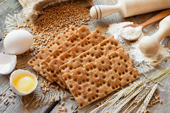 Grain Crispbread, cereal crackers on table Royalty Free Stock Images