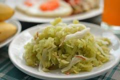 grain déchiqueté de riz avec le thaifood de chair et de banane de noix de coco photo stock