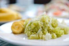 grain déchiqueté de riz avec le thaifood de chair et de banane de noix de coco photographie stock libre de droits