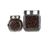 Grain de café dans la bouteille en verre Photographie stock libre de droits