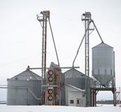 Grain dryer and silos in winter Stock Photo